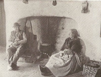 A couple by the fireside in a cottage on Aran.