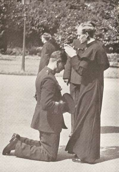 A priest blesses a garda.