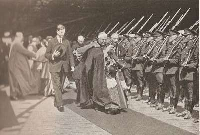 Eamon De Valera walks with church leaders.